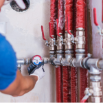 plumber checking water pipes
